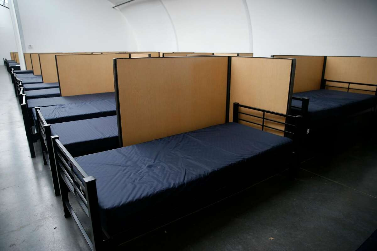 Beds and partitions are already in the dormitories as construction is nearing completion on the homeless navigation center on The Embarcadero in San Francisco, Calif. on Thursday, Dec. 12, 2019.