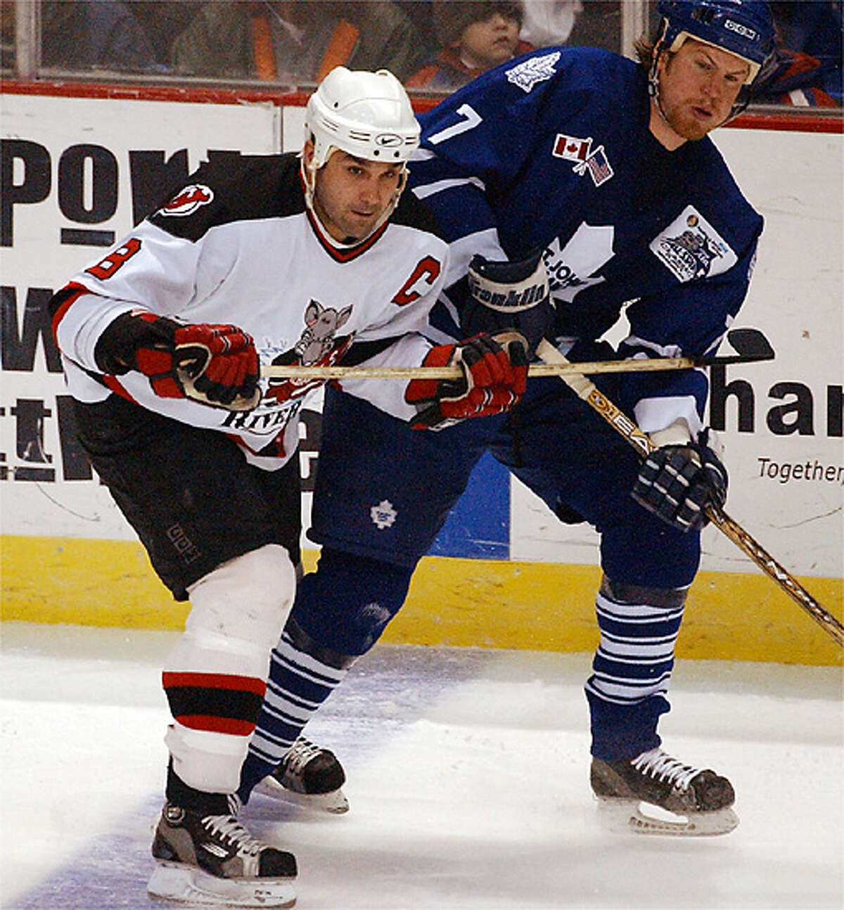 Mar. 27, 2002: Albany River Rats #8-Sylvain Cloutier battles St. John's Maple Leafs #7-Andre Payette in the first period of game at the Pepsi Arena.