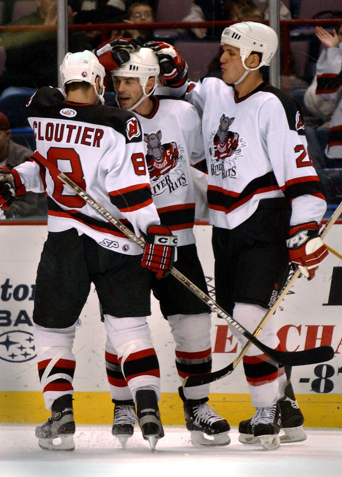 The Albany River Rats' Bruce Gardiner, center, is congratulated by teammates Sylvain Cloutier and Lucas Nehrling after he put Albany on the board with a goal in the second period of Friday's hockey game against Worcester at the Pepsi Arena February 22, 2002.