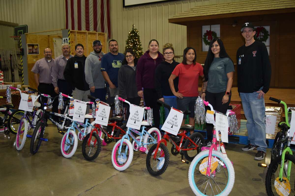 Walmart DC associates pose with the bikes collected by an estimated 880 local Walmart employees. The bikes were donated to the Plainview Salvation Army for distribution to local families.