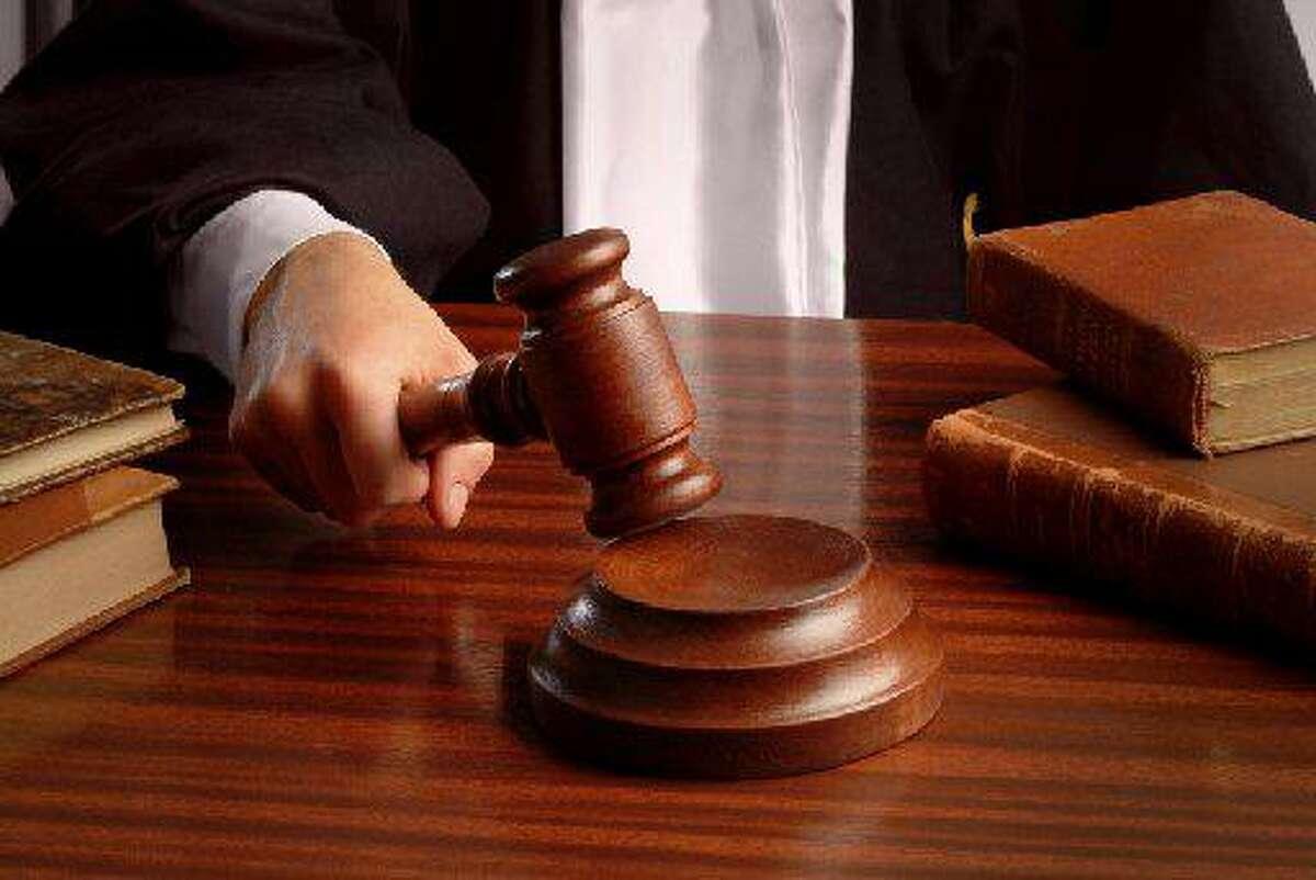 Judge with judge's gavel.