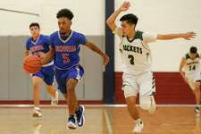 Memorial's Michael McGlothlin, left, led all scorers with 28 points as Memorial beat Kennedy 73-64 on Dec. 10.
