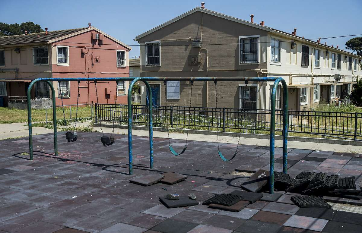 A deteriorating playground sits among rows of public housing units Wednesday, April 25, 2018 in the Sunnydale neighborhood of San Francisco, Calif.