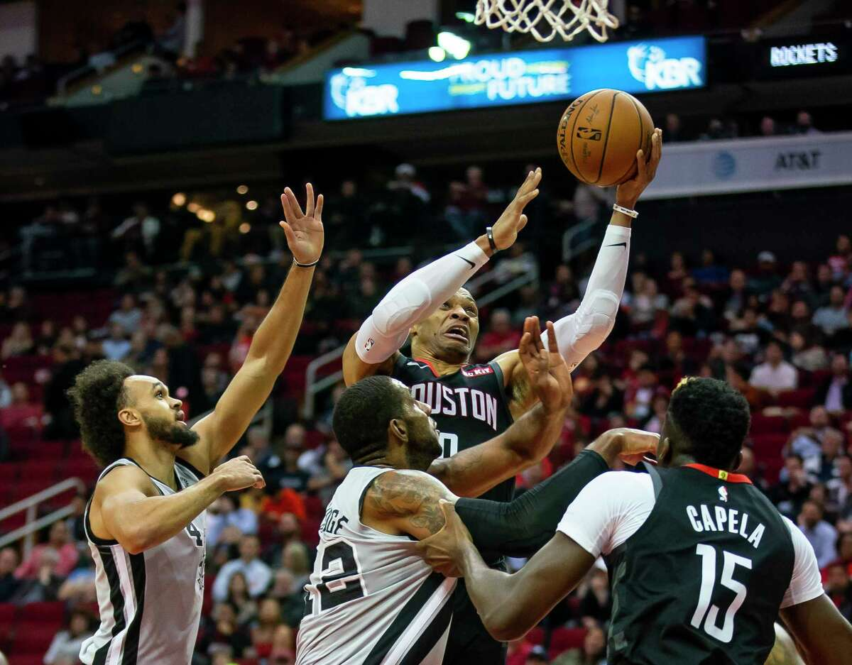 Houston Rockets guard Russell Westbrook (0) shoots during the first quarter of the Rockets game against the Spurs at Toyota Center in Houston, Monday, Dec. 16, 2019.