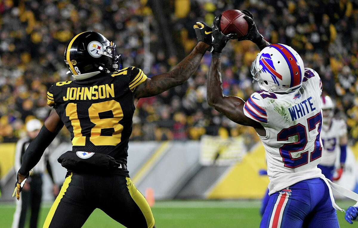 PITTSBURGH, PA - DECEMBER 15: Tre'Davious White #27 of the Buffalo Bills intercepts a pass intended for Diontae Johnson #18 of the Pittsburgh Steelers in the third quarter during the game at Heinz Field on December 15, 2019 in Pittsburgh, Pennsylvania. (Photo by Justin Berl/Getty Images)
