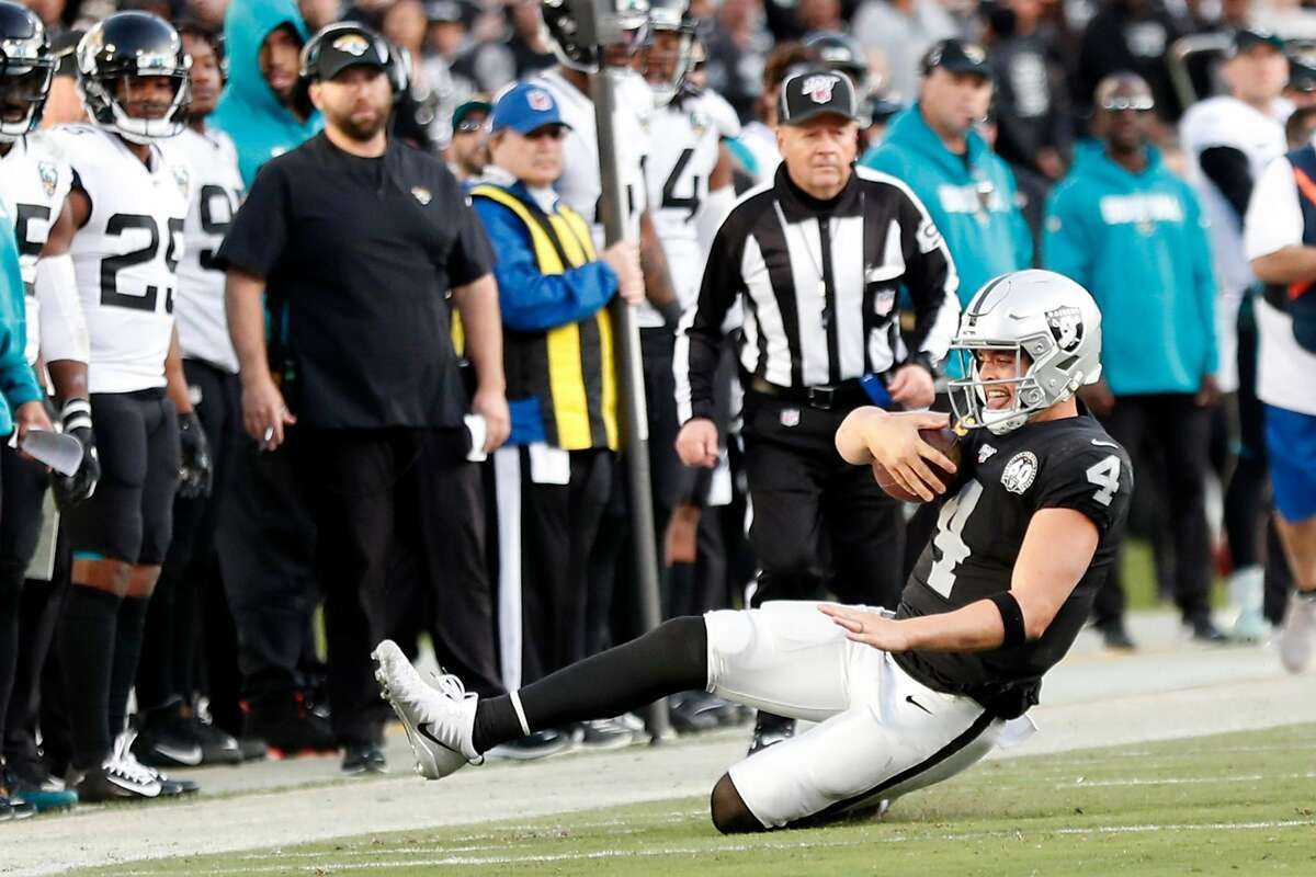 Oakland Raiders' Derek Carr slides after rushing for a 1st down in 4th quarter during Jacksonville Jaguars' 20-16 win during Raiders' final game at Oakland Coliseum in Oakland, Calif., on Sunday, December 15, 2019. Carr was ruled out of bounds and the clock stopped at 2:05 instead of running down to the two minute warning.