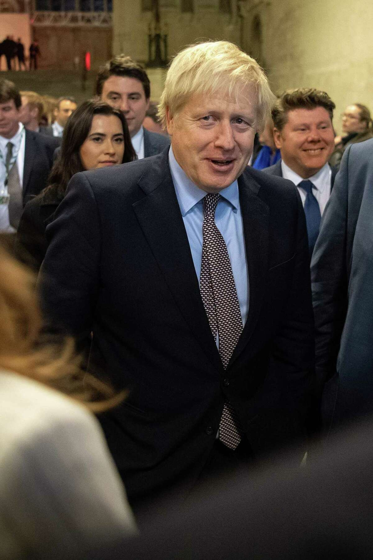 Britain's Prime Minister Boris Johnson talks to newly-elected Conservative MPs in Westminster Hall in the Palace of Westminster, central London on December 16, 2019. - Prime Minister Boris Johnson got down to work Monday following his sweeping election victory, appointing ministers and announcing plans to publish legislation this week to get Britain out of the European Union. (Photo by Leon Neal / POOL / AFP) (Photo by LEON NEAL/POOL/AFP via Getty Images)