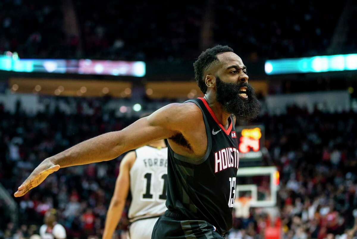 Houston Rockets guard James Harden (13) celebrates after dunking as the Rockets pull into the lead during the fourth quarter of the Rockets game against the Spurs at Toyota Center in Houston, Monday, Dec. 16, 2019.