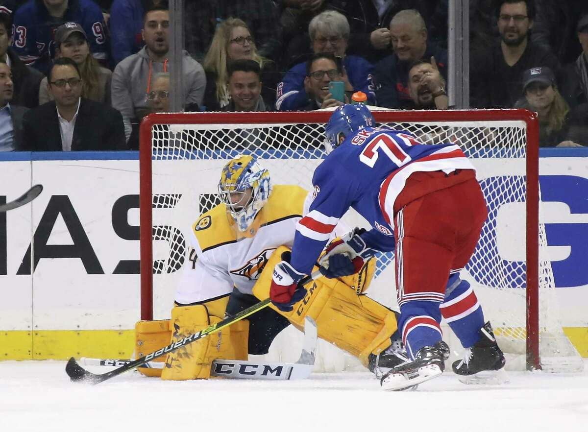 NEW YORK, NEW YORK - DECEMBER 16: Juuse Saros #74 of the Nashville Predators makes the first period stop on Brady Skjei #76 of the New York Rangers at Madison Square Garden on December 16, 2019 in New York City. (Photo by Bruce Bennett/Getty Images)