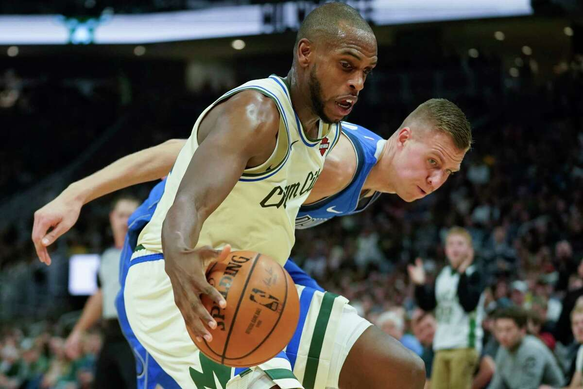 Milwaukee Bucks' Khris Middleton steals the ball from Dallas Mavericks' Kristaps Porzingis during the first half of an NBA basketball game Monday, Dec. 16, 2019, in Milwaukee. (AP Photo/Morry Gash)