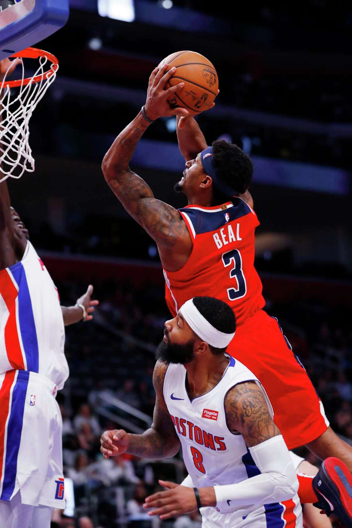 Washington Wizards guard Bradley Beal (3) drives on Detroit Pistons forward Markieff Morris (8) in the second half of an NBA basketball game in Detroit, Monday, Dec. 16, 2019. (AP Photo/Paul Sancya)