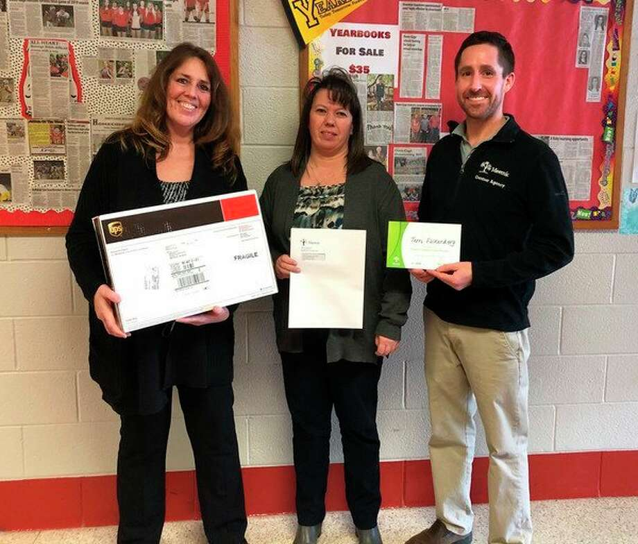 Owen-Gage School superintendent Terri Falkenberg is pictured with grant recipeint Sherry Fritz and Dan Gentner from Gentner Insurance. (Submitted Photo)