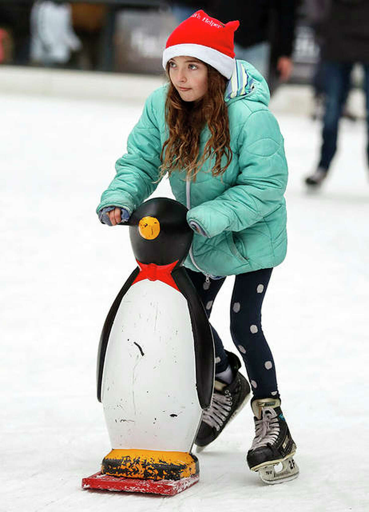 A girl skates at McCormick Tribune Ice Rink in Chicago's Millennium Park. The outdoor ice rink is open through February if weather permits.