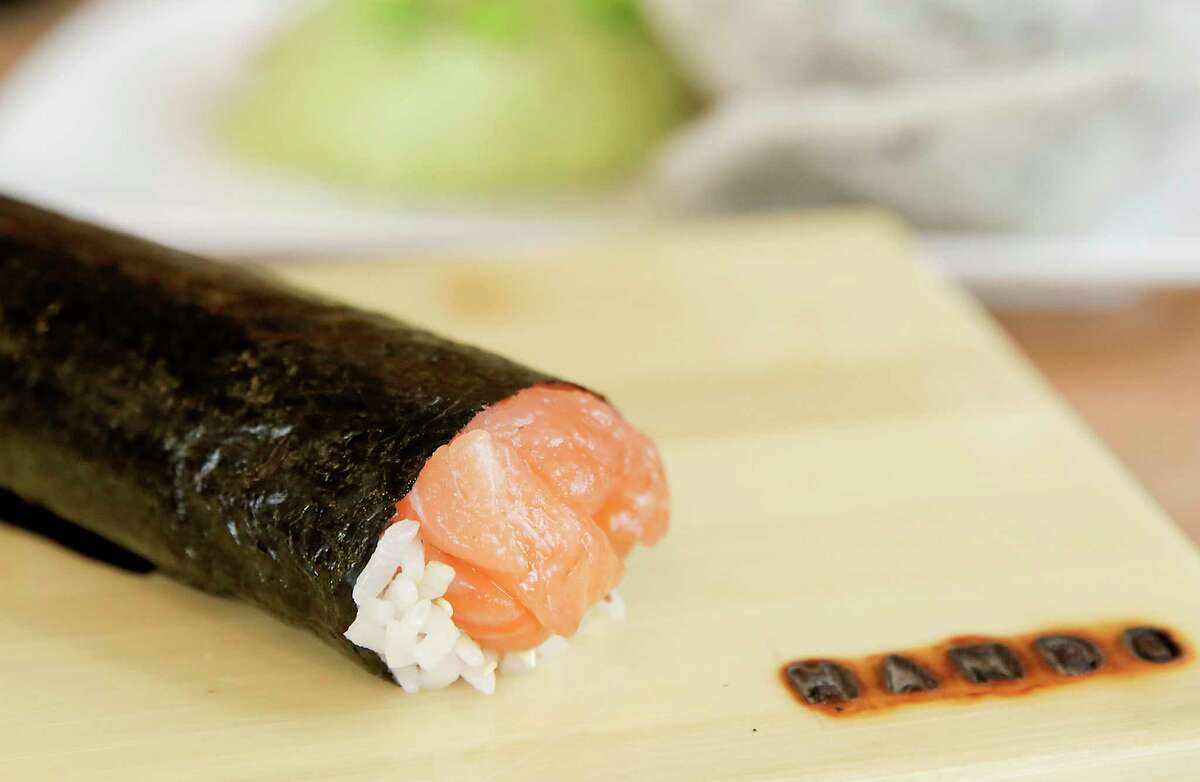 A salmon hand roll at Hando, a new 22-seat hand roll sushi bar opening in the Heights this week.