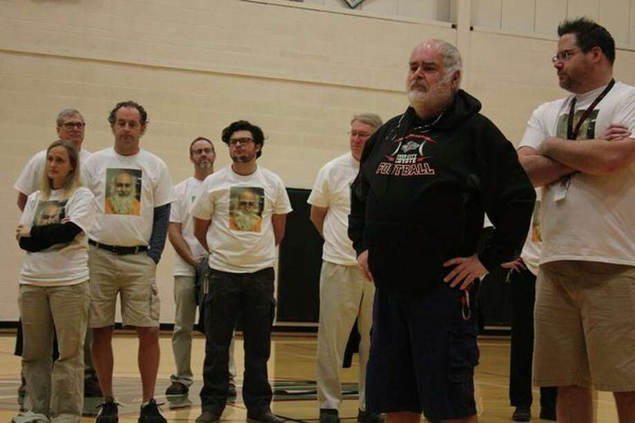 RCHS staff stands next to Scharlow, wearing t-shirts with his face on it. The t-shirts were made to raise money for Katie's Kloset, an organization created in honor of his daughter, who died of cancer in 2012. (Courtesy photo)