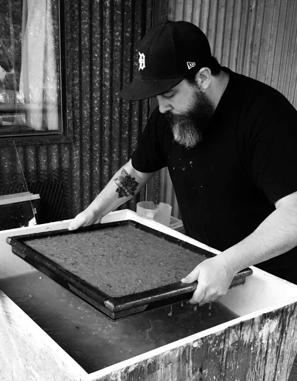 Pennsylvania-based artist Adam DelMarcelle makes a sheet of paper from pulp made from the clothing of victims of drug overdoses. Troy Foundry Theatre is presenting the one-man show