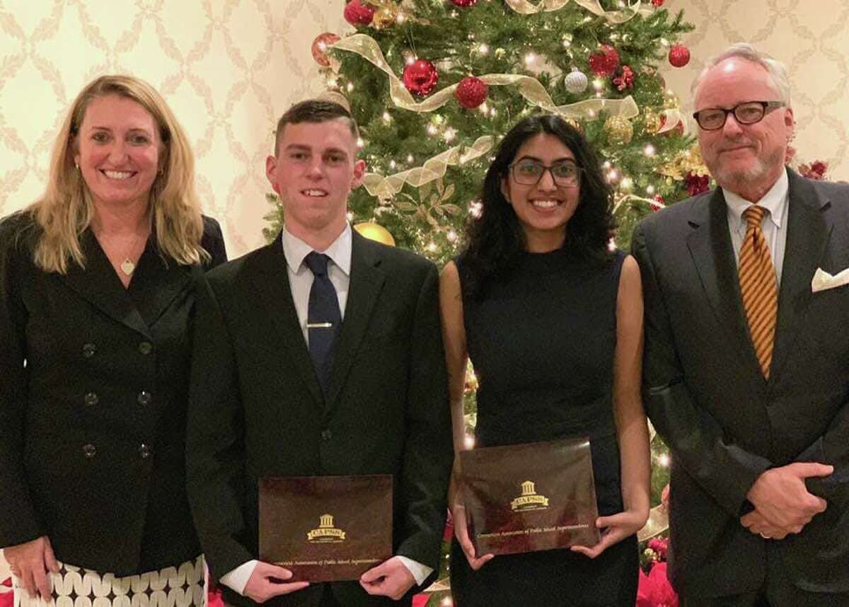 Shelton High Principal Kathy Riddle and school Superintendent Chris Clouet with high school award-winners Christopher Belden and Ananya Yadav at the Connecticut Association of Public School Superintendents (CAPSS) Superintendent/Student Recognition Award ceremony.