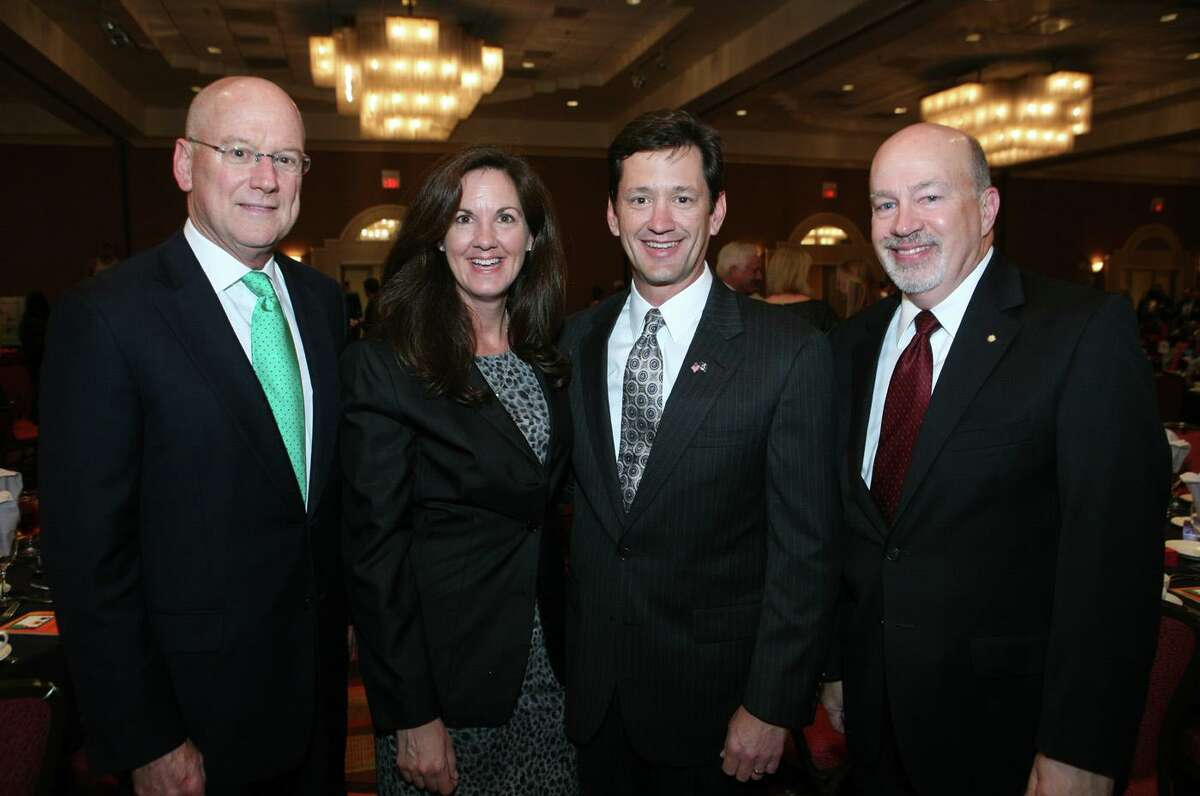 Wayne Peacock, second from right, will become USAA's CEO and president on Feb 1. He is pictured with his wife, Ginny; Dr. William Henrich; and Fred Hines at a Clarity Child Guidance Center gala in 2011.