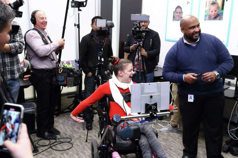 Alexis Mendoza, 23, tries out the new Comcast X1 Eye Control Technology on Tuesday, Dec. 10, at Easter Seals Greater Houston. The technology allows people with disabilities to be able to operate their TVs with the gaze of an eye. Photo: Photo By Quy Tran