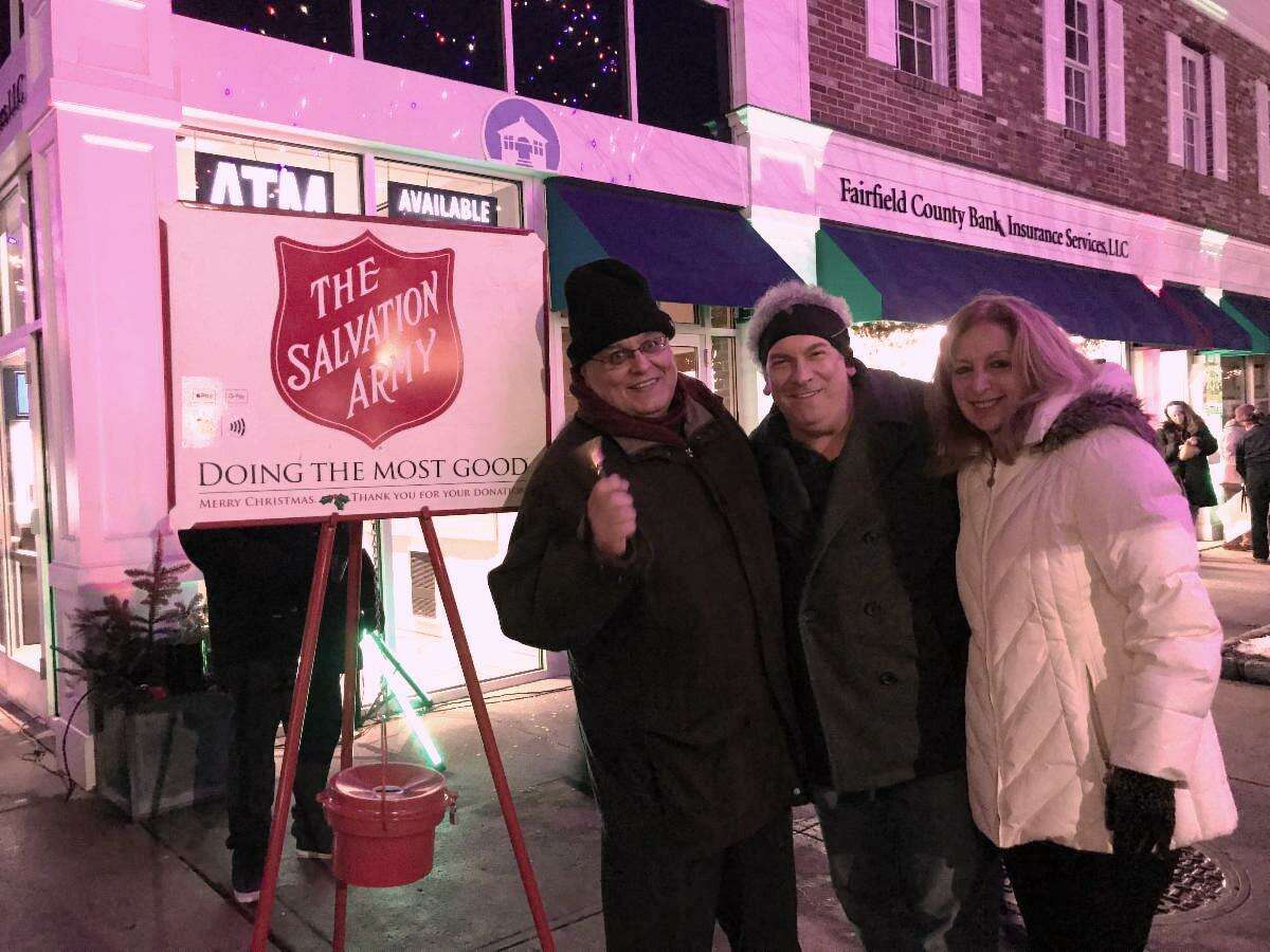 """Ridgefield Realtors """"Rang the Bell"""" for the Salvation Army at numerous locations throughout town rhis past weekend. The Realtors collected over $1,400 to help Ridgefield neighbors in need. Ninety percent (90%) of all funds collected goes directly to Ridgefield Social Services. Pictured above: Realtor Art Meyer spreading cheer at the Holiday Stroll."""