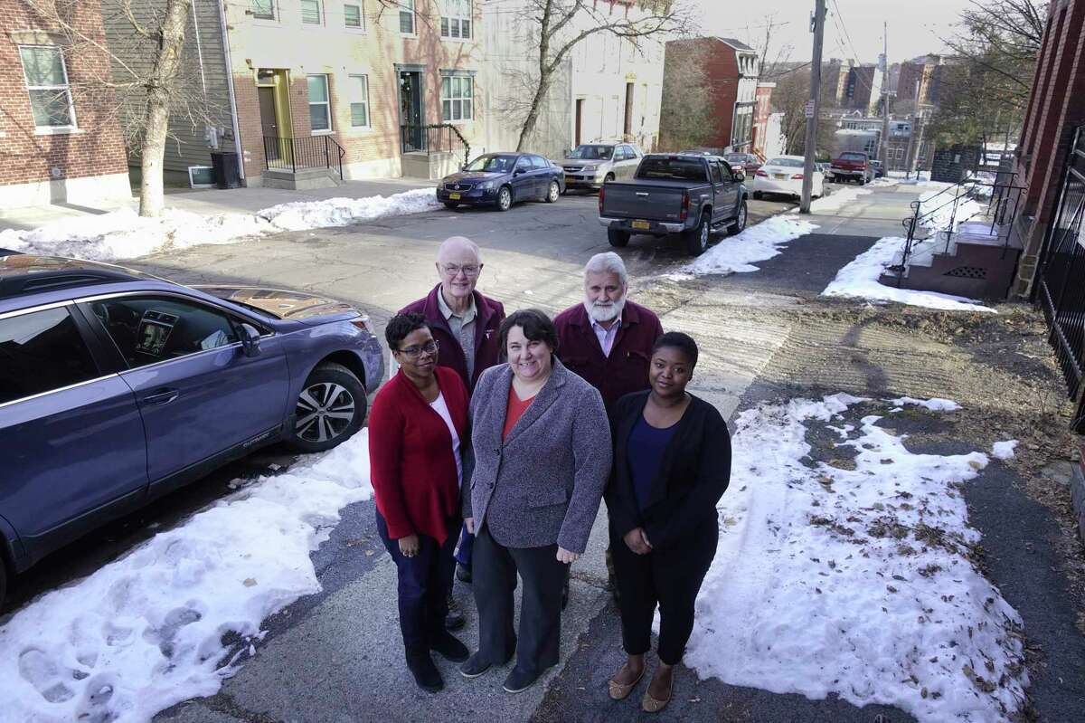 Members of the South End Improvement Corporation, from left to right, Yolanda Mott, intake coordinator, Eric Fagans, president of the board, Cynthia Herbach, executive director, Dave Schultz, rehab and development manager, and Jocelyn Archer, community engagement and marketing coordinator, pose for a photo outside the corporation's office on Catherine Street on Thursday, Dec. 12, 2019, in Albany, N.Y. (Paul Buckowski/Times Union)