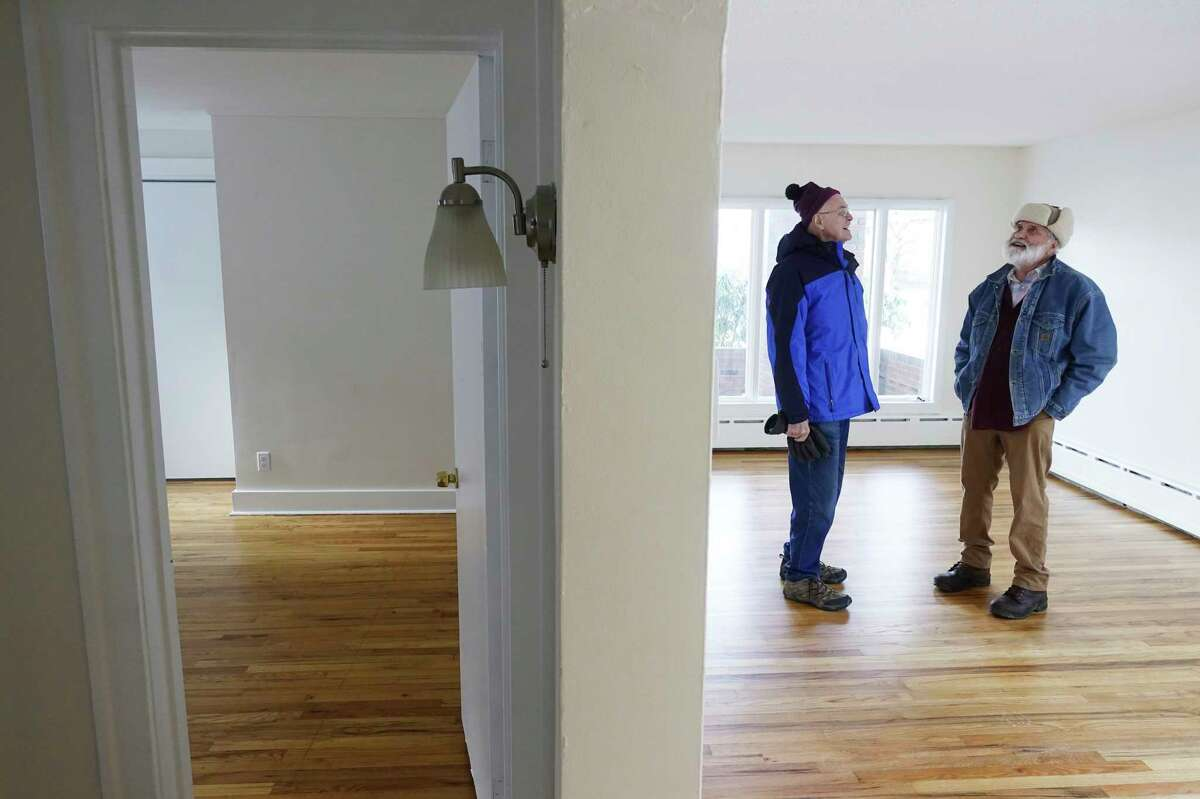 Members of the South End Improvement Corporation, Eric Fagans, left, president of the board, and Dave Schultz, rehab and development manager, look over a home on Holmes Court purchased by the corporation and rehabbed on Thursday, Dec. 12, 2019, in Albany, N.Y. (Paul Buckowski/Times Union)
