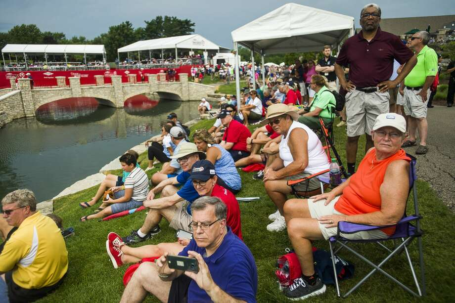 Fans watch the final round of the inaugural Dow Great Lakes Bay Invitational at the Midland Country Club on July 20, 2019. Photo: Daily News File Photo