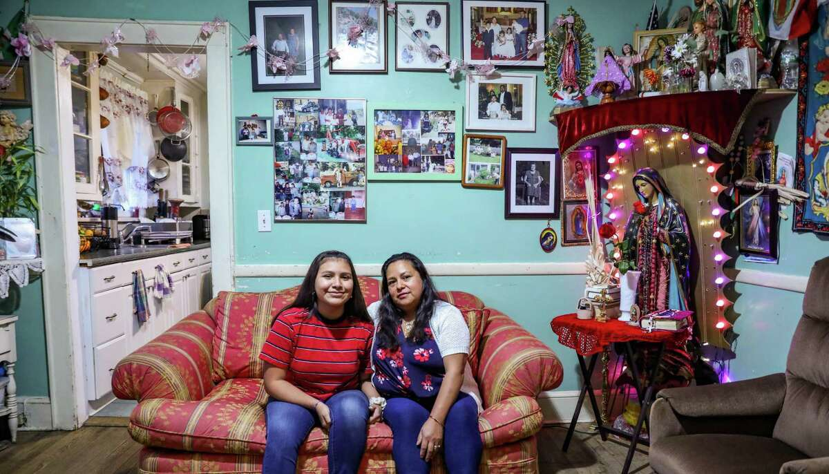 Emelia Huerta and her daughter Flor in the living room of their Bridgeport home. Huerta worked through a temp agency as a housekeeper. She said she often worked more hours then she was originally scheduled. Those extra hours were never paid. She quit and now runs her own cleaning service.