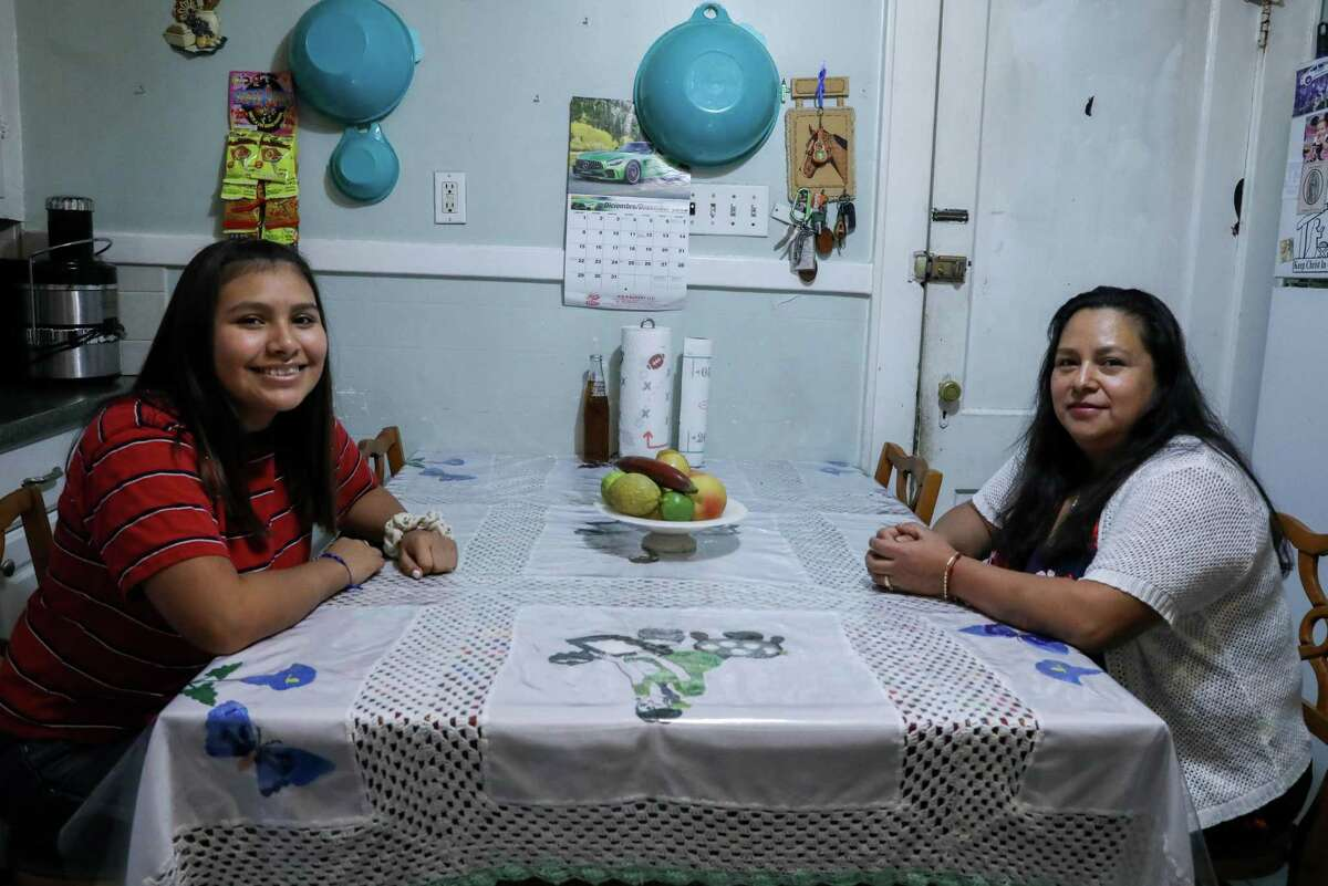 Emelia Huerta and her daughter Flor in the kitchen of their Bridgeport home. Huerta worked through a temp agency as a housekeeper. She said she often worked more hours then she was originally scheduled. Those extra hours were never paid. She quit and now runs her own cleaning service.