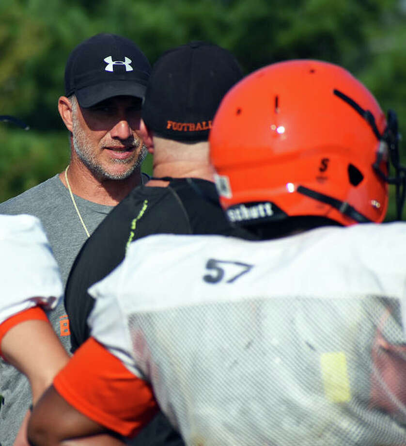 Edwardsville football coach Matt Martin watches his players practice during a summer session before the 2019-20 school year. Photo: Matt Kamp|The Intelligencer