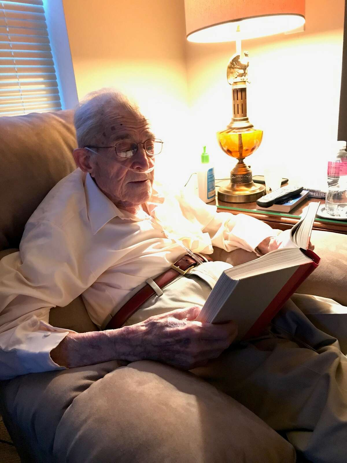 Don Black, a World War II vet, reads in his new electric recliner at Brookdale, an assisted-living facility in Niskayuna, six months after a terrifying fall and broken hip and cancer diagnosis.