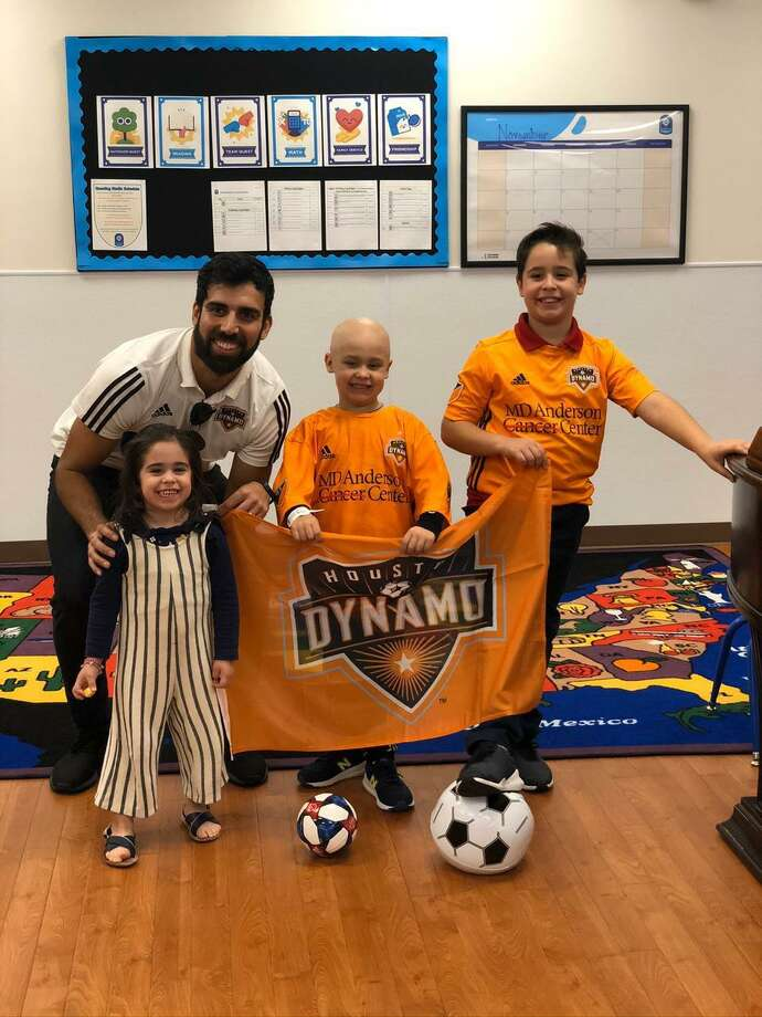 Houston Dynamos' Kevin Garcia visits six-year-old battling with a rare form of cancer. Photo: Photos Provided