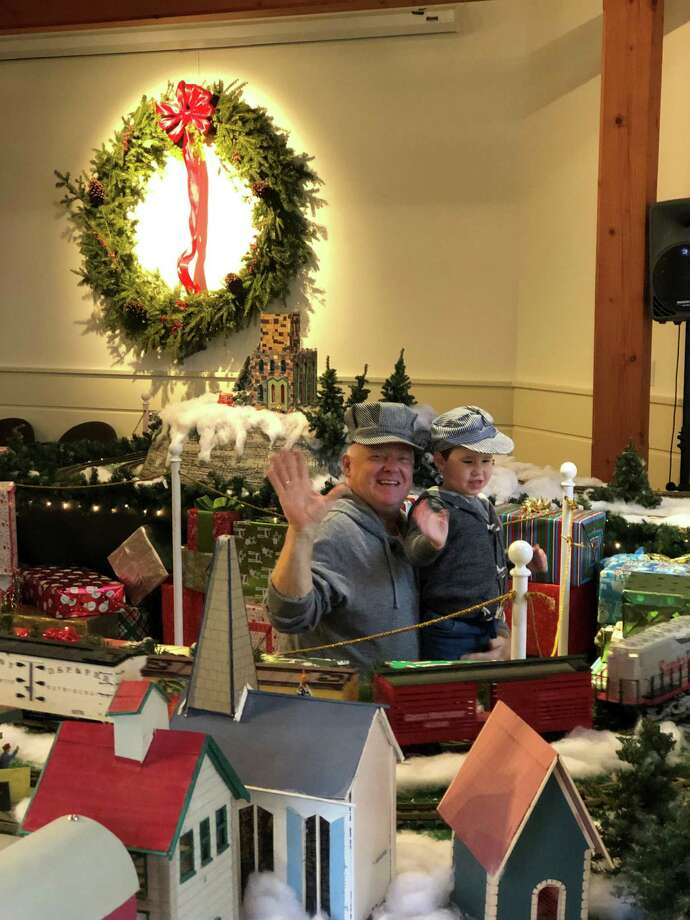 A grandfather and grandson at the Holiday Train Show. Photo: Contributed Photo