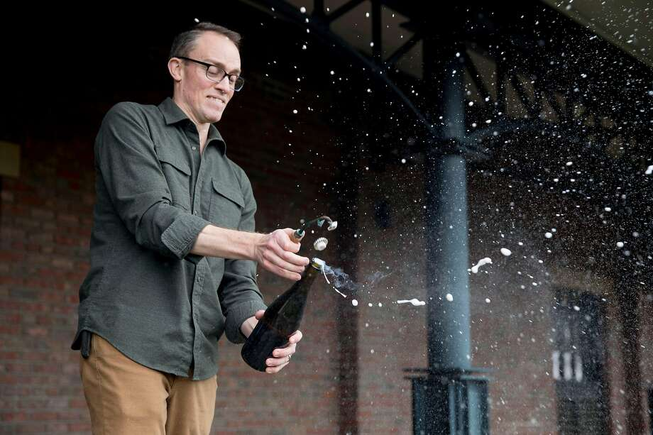 Dan Person, shown here disgorging a bottle of wine, was formerly a winemaker at Schramsberg, a leading sparkling wine producer. Photo: Jessica Christian / The Chronicle