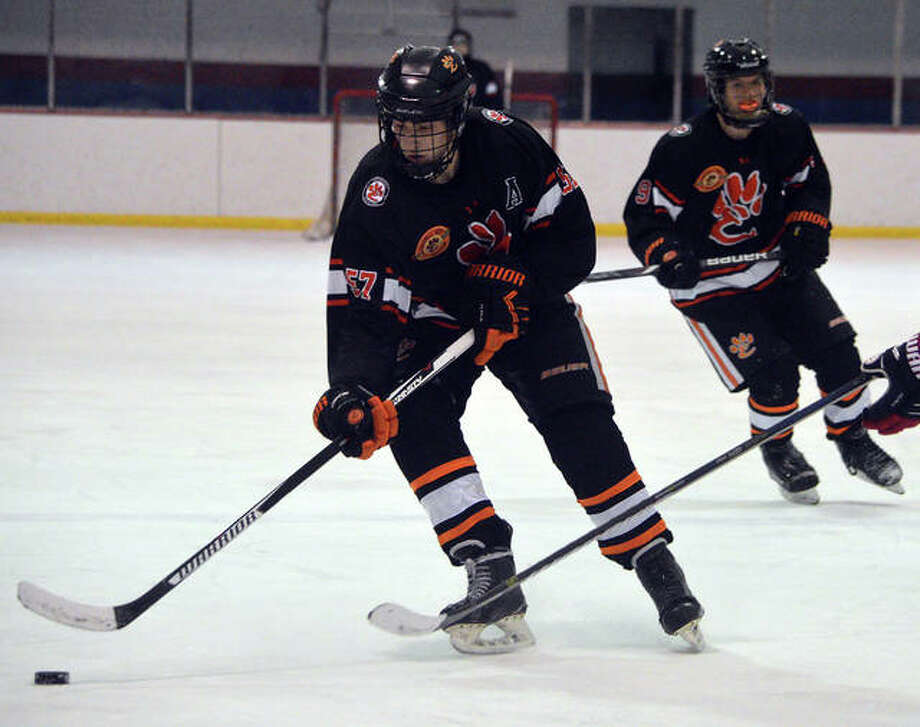 Edwardsville's Justin Harper controls the puck during Saturday's game against CBC at the Affton Ice Rink. Photo: Scott Marion/The Intelligencer