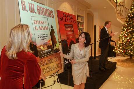 EMBARGOED FOR SOCIETY REPORTER UNTIL DEC. 20  Julie Baker Finck, from left, Maria Bush and Neil Bush at the Barbara Bush Literacy Foundation's, A Celebration of Reading's Author Announcement Party on December 12, 2019.