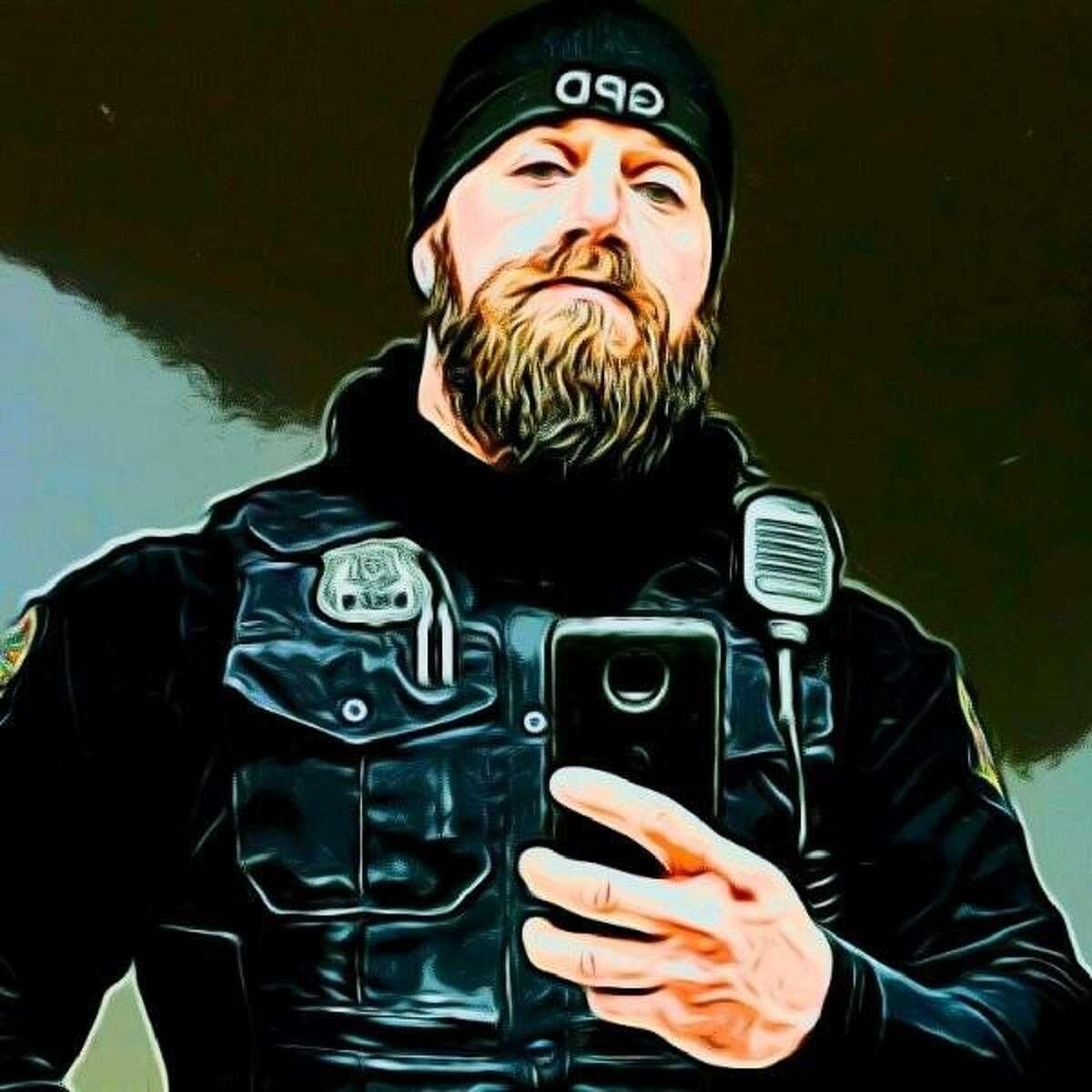 A social-media portrait of Officer Quagliani
