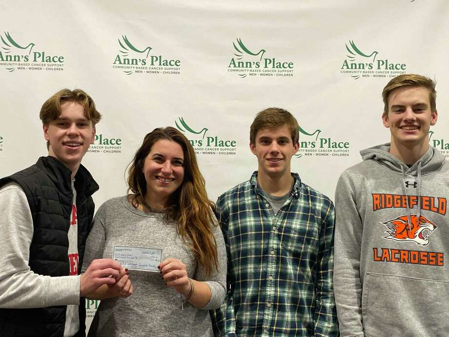 The captains of the Ridgefield High School boys soccer team presented a check for $905 to Ann's Place earlier this month. The money was money raised by the RHS Boys Soccer Program during their Play for Pink efforts this season. Pictured, from left to right: Ben Ragland, Rebekah Harriman-Stites of Ann's Place, Tim Vanni and Ray Dearth. Ann's Place is a tremendous local resource for support and guidance for patients and their families in a journey with cancer. Photo: Contributed Photo
