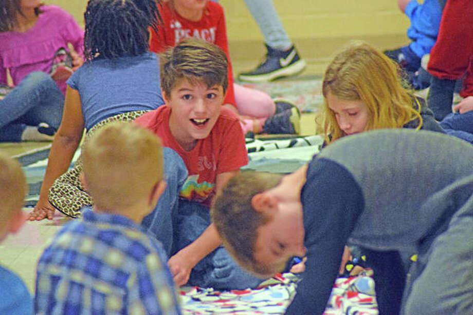 Silver Creek Elementary School students diligently work together on Friday in Troy to make blankets for children in foster care. Photo: Tyler Pletsch | The Intelligencer