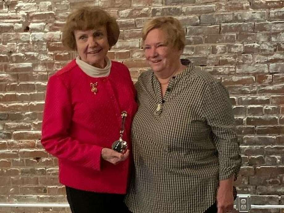 Judy Kelley receives the 2019 Silver Spoon Award from Godfrey Women's Club President Pam Whisler.