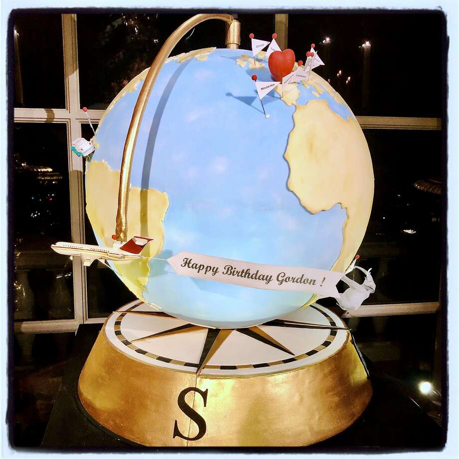 Gordon Getty celebrated his 86th with a rotating globe cake. Dec. 14, 2019. Photo: Catherine Bigelow / Special To The Chronicle