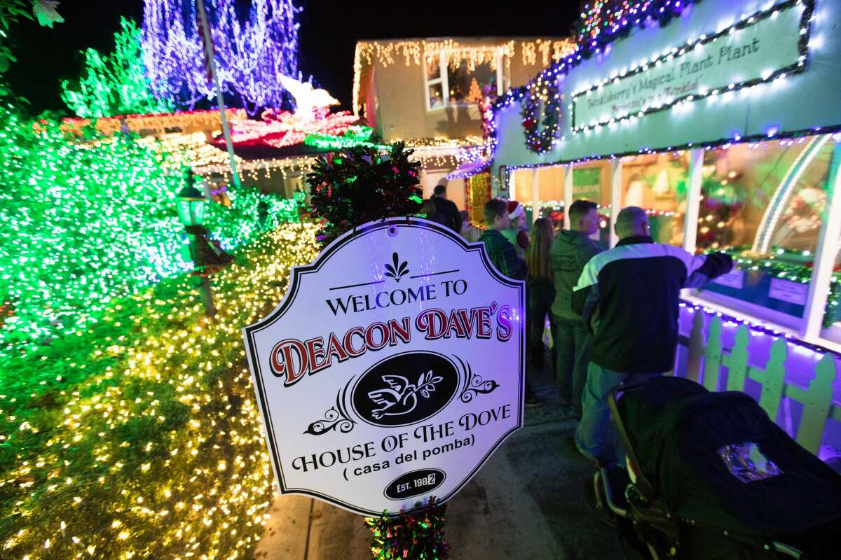 A sign welcomes visitors to the Deacon Dave's House of the Dove (Casa Del Pomba) Christmas lights display. For the past 37 years Deacon Dave Rezendes has invited the public to view his Christmas lights display in the front yard of his home in Livermore for free. It has grown to include over 640,000 lights, the most of any home display in the Bay Area.