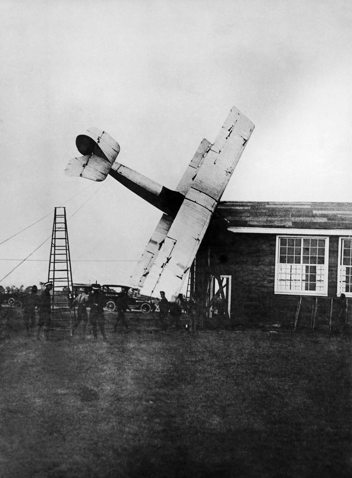 A photographer captures an airplane crash on May 4, 1919, in Texas.