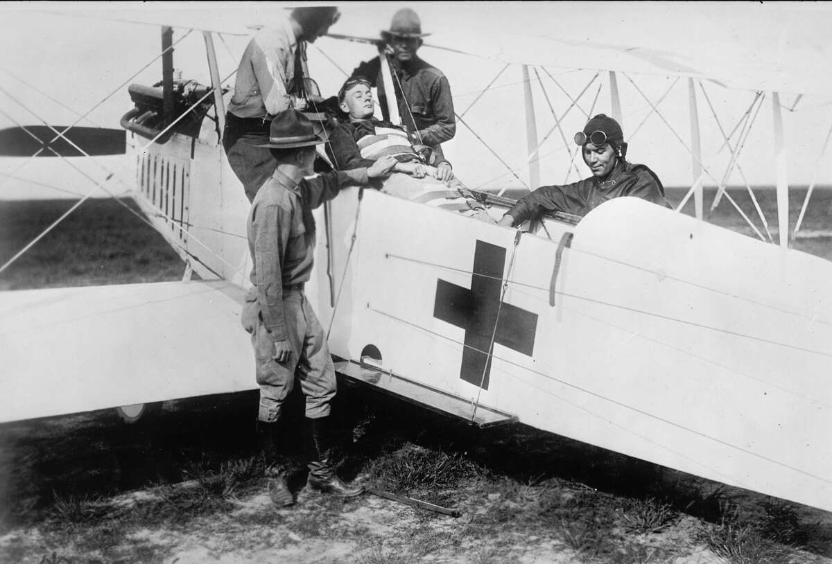 At Ellington Field, soldiers demonstrate the use of a hospital plane to provide aid to wounded men in Houston, Texas, 1919. The year saw the end of World War I, the global devastation of Spanish flu, racial strife in the U.S. and the rise of oil giants. >>>See more images of notable moments in history from 100 years ago ...