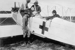 At Ellington Field, soldiers demonstrate the use of a hospital plane to provide aid to wounded men, Houston, Texas, 1919. (Photo by PhotoQuest/Getty Images)