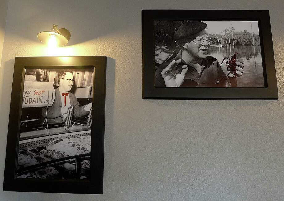 A multitude of family photographs and eclectic lighting and decor fill the dining space at Judice's 1927 in Nederland. The restaurant's opening went through multiple delays, but the Judice family has brought their 100-year tradition of Cajun cooking to Nederland Avenue.  Photo taken Monday, August 5, 2019  Kim Brent/The Enterprise Photo: Kim Brent / The Enterprise / BEN