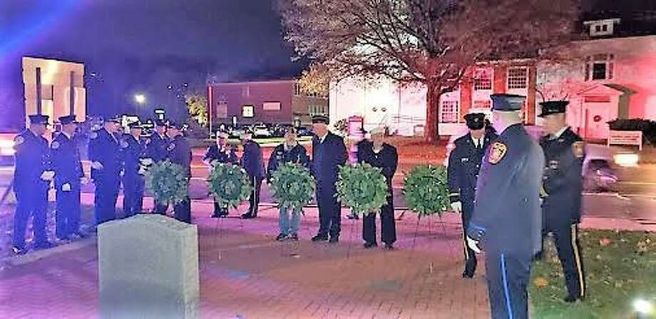 The town of Seymour and VFW Post 12084 recently held its annual Veterans Day candlelight vigil ceremony at Broad Street Park. Photo: Contributed Photo