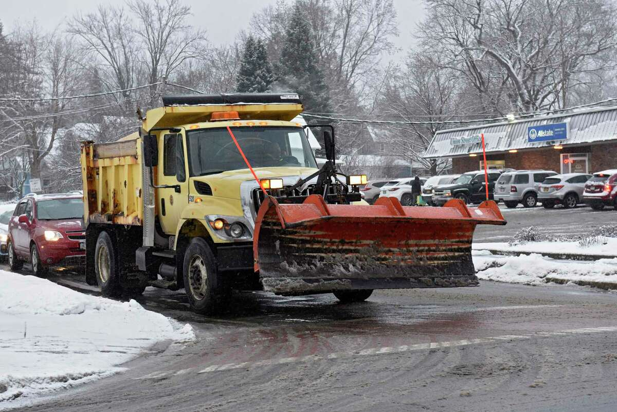 A snow plow is seen on Palmer Ave. waiting to turn on to Union Ave. during a snow storm on Tuesday, Dec. 17, 2019 in Schenectady, N.Y. (Lori Van Buren/Times Union)