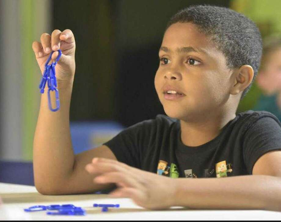 Thomas Smith, 7, of Danbury, takes part in a program, by ImagArena, in Danbury Library Children's Corner, Wednesday afternoon, June 13, 2018, in Danbury, Conn. Photo: H. John Voorhees III