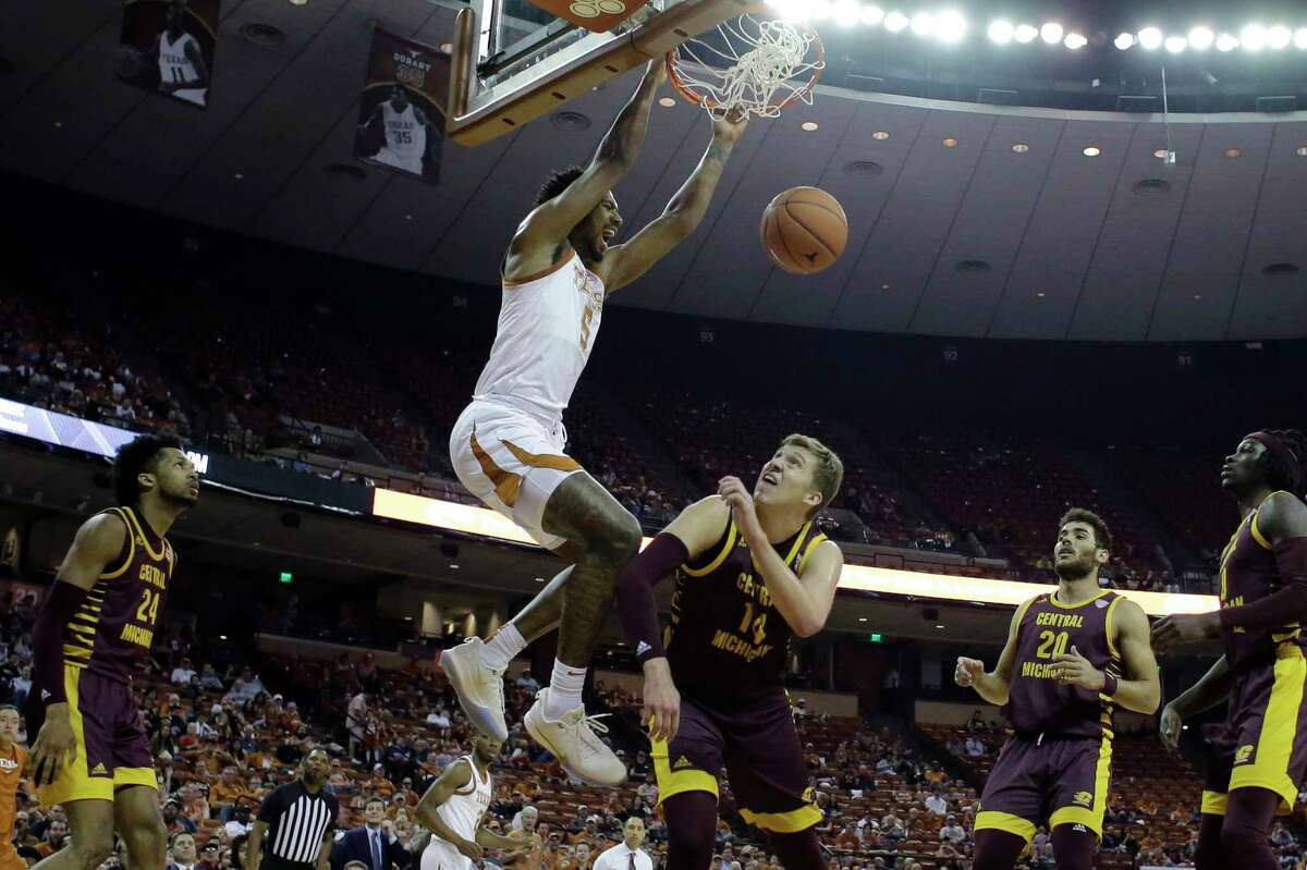 Texas forward Royce Hamm Jr. scores over Central Michigan's David DiLeo (14) during the Longhorns' victory Saturday in Austin.